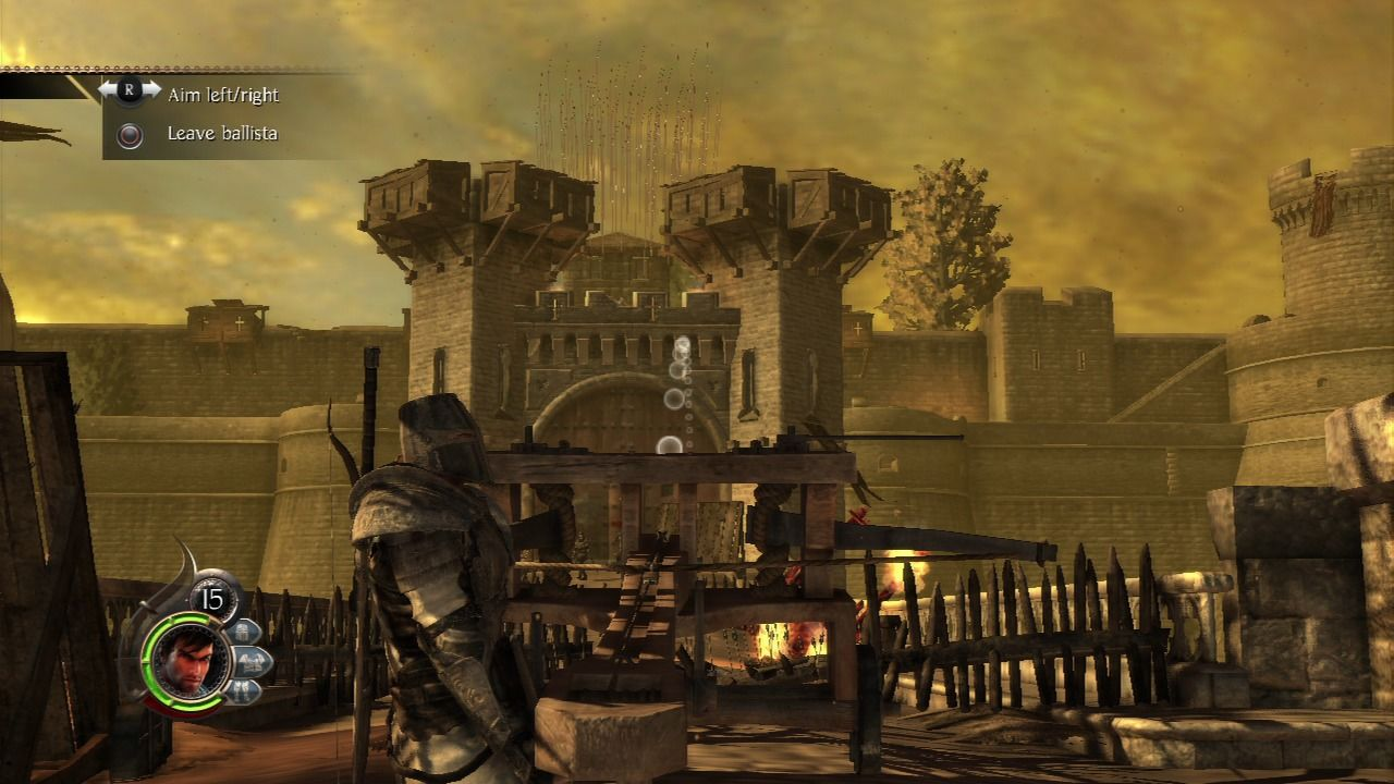 The Cursed Crusade PlayStation 3 Using ballista to wreak havoc on the gate tower.