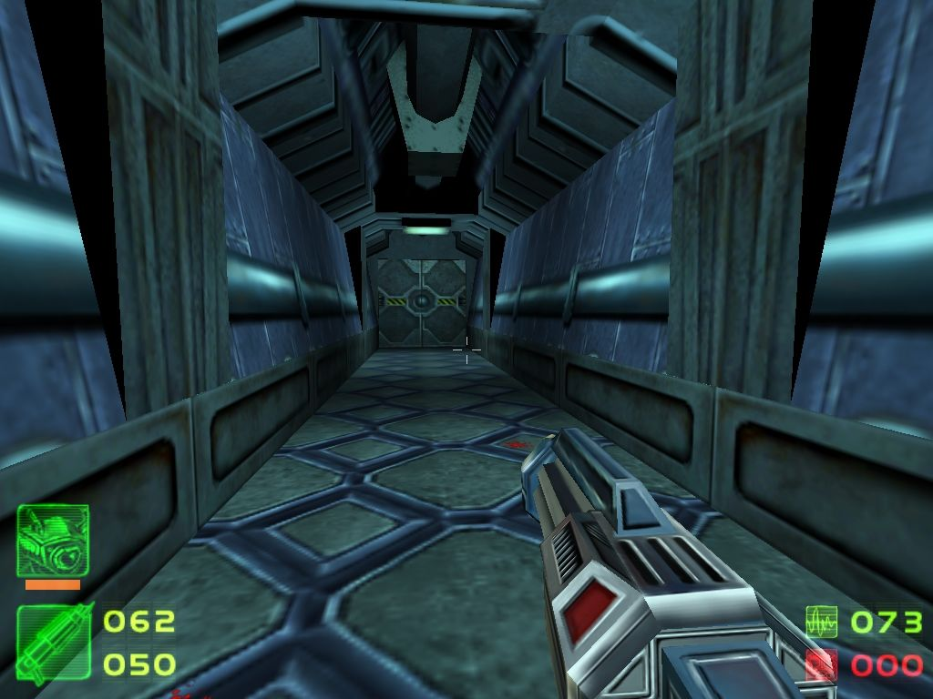 Skout Windows Base corridor. Player is holding the Partikelstreuer, a chaingun-like weapon.