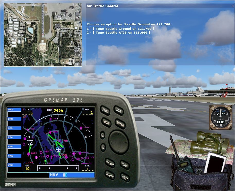2005 Traffic Windows Selecting items in the plane spotters bag opens up the ATC window, the top down view, the GPS and a clock. The binoculars opens the flight simulator's map view which takes over the whole screen
