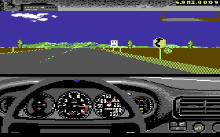 The Duel: Test Drive II Commodore 64 Driving the Ferrari. A road sign warns of a curvy road ahead.