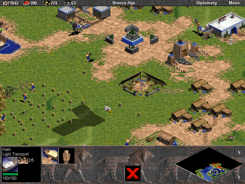 Age of Empires (Demo Version) Windows Bronze Age town centre with a market and a temple.