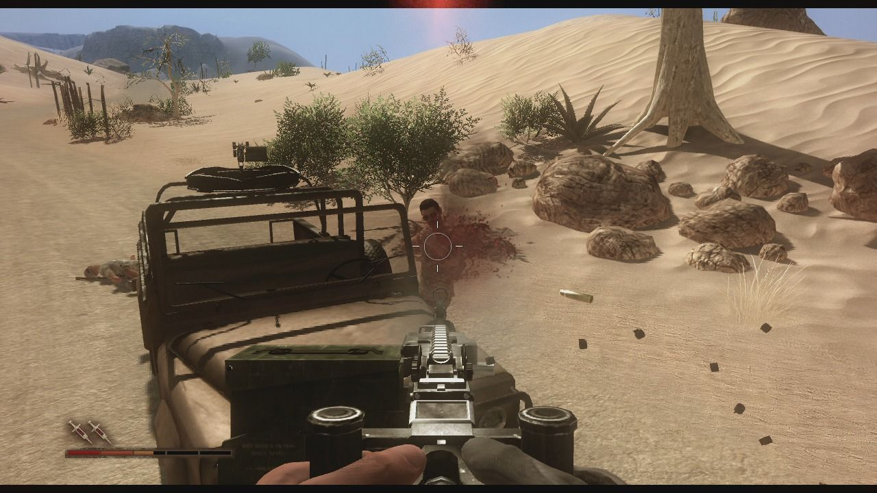 Far Cry 2 Xbox 360 Taking care of the enemy patrol.