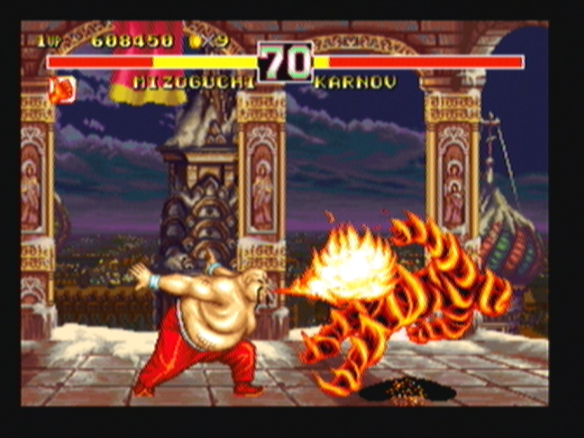 Fighter's History Dynamite Zeebo Karnov sets Misogushi ablaze with his Fire Breath.