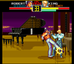 Art of Fighting SNES Here, Robert is teaching King how to do a waltz... or not.
