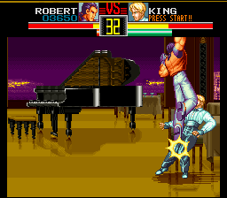 Art of Fighting SNES Robert finishing off King. If you beat her with a special move, her shirt will rip off!