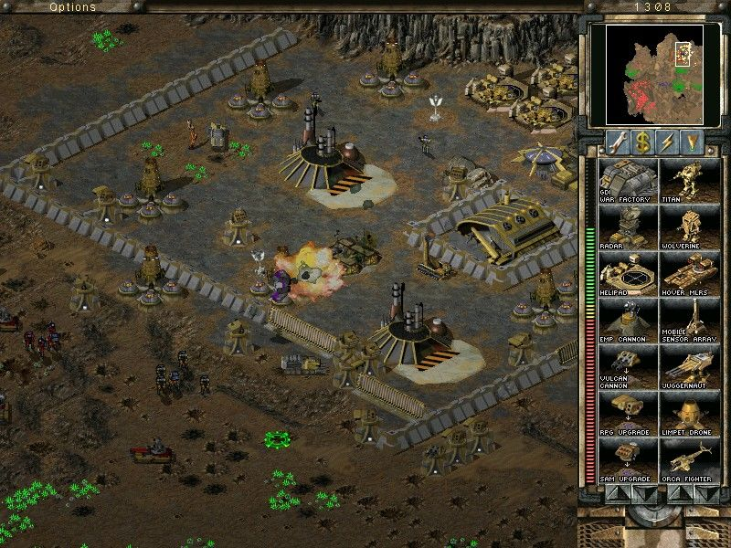Command & Conquer: Tiberian Sun - Firestorm Windows Heavily fortified base defenses clipping the wings of a Nod fighter.