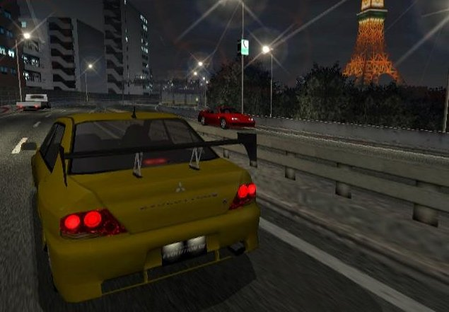 Tokyo Xtreme Racer 3 PlayStation 2 Evo 7 crusing past the Tokyo Tower