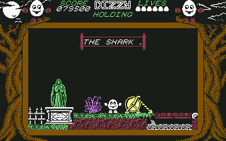 Dizzy: The Ultimate Cartoon Adventure Commodore 64 The shark infested moat.