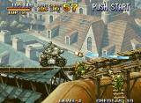 Metal Slug: Super Vehicle - 001 Neo Geo On top of one of the houses