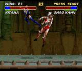 Ultimate Mortal Kombat 3 SNES Kitana applies a super kick in this skull-masked-tough-man... Wait! I've seen this face before!