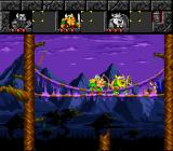 The Lost Vikings SNES On a bridge, fighting a slug