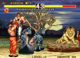 Fighter's History Dynamite Neo Geo Zazie holds Mizuguchi up in the air