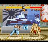 Street Fighter II Turbo SNES Ryu throws a Hadouken in direction to Honda, but what will do the Sumo fighter: jump or defend?