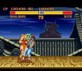 Street Fighter II Turbo SNES Balrog's throw (with high punch) is not a throw, but a series of hits with the head.