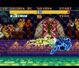 Street Fighter II Turbo SNES Bison's Psycho Crusher in action, hitting (and burning) Vega.