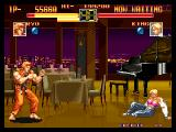 Art of Fighting Neo Geo King defeated. Notice King's pink bra?