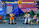 Fatal Fury 2 Neo Geo Joe Higashi and Kim Kaphwan fighting in Korea at night. Notice the small cameo by a motorcycle-riding Tung Fu Rue in the background.
