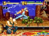 Fatal Fury 2 Neo Geo Big Bear takes an undesirable Bruce Lee-esque flying kick in the face from Terry Bogard.