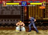 Fatal Fury 3: Road to the Final Victory Neo Geo Geese Howard crouches down (possibly to avoid getting a Snake Arm to the face?). Do you notice the train in the background?