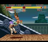 Super Street Fighter II SNES Ryu being damaged by M. Bison's Flying Psycho Fist.