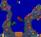Disney's Ariel the Little Mermaid Game Gear Bad fish are hiding in the rocks