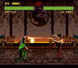 "Mortal Kombat II SNES Projectile clash between Reptile's Force Ball and Liu Kang's High ""Dragon"" Fireball."