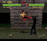 Mortal Kombat II SNES Liu Kang attacks with his Flying Kick and Noob Saibot makes the respective blocking position.