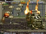 Metal Slug 4 Neo Geo A big truck are blocking your passage and trying to kill you shooting a serie of parachute missiles.