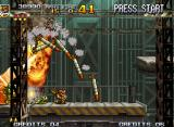 Metal Slug 4 Neo Geo Nadia does a good performance shooting in an enemy Bradley Tank that launches a big row of missiles.
