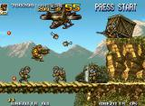 Metal Slug 5 Neo Geo Tarma throws some bombs, aiming at to disassemble a battle formation created by an enemy troop.