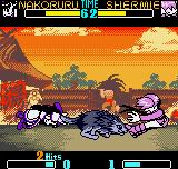 SNK Gals Fighters Neo Geo Pocket Color Grabbed in the tail of her pet wolf Silkou, Nakoruru smashes Shermie in a hyper frontal attack.
