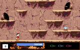 Disney's Duck Tales: The Quest for Gold Amiga Climbing to the top of the rock.