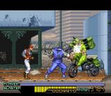 The Ninja Warriors SNES Ninja throws a heavy-weight motorcycle in a guard, but the danger is soon behind him...