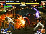 The King of Fighters '99: Millennium Battle Neo Geo Robert blocks the offensive formed by Kyo's Orochinagi and Iori's DM Ura 311 Shiki: Saku Tsumagushi.