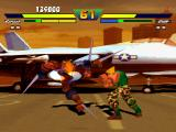 Street Fighter EX Plus Alpha PlayStation Garuda attacks with his anti-air move Kizan and Guile tries to stop his offensive with a Sonic Boom.