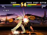 Street Fighter EX 2 Plus PlayStation Cracker Jack smashing Sharon with 5 hits of his heavyweight Super Combo Crazy Jack.