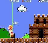 Super Mario Bros. Deluxe Game Boy Color Jumping and grabbing the flagpole, Mario finishes Level 1-1 scoring 5.000 points.