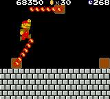 Super Mario Bros. Deluxe Game Boy Color During his way through Level 1-4, Mario tries a risky jump between two fire chains.