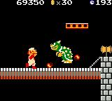 Super Mario Bros. Deluxe Game Boy Color Before Bowser spits his fireball, Mario strikes back shooting some fireballs too.