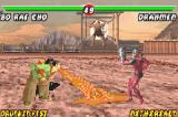 Mortal Kombat: Tournament Edition Game Boy Advance Trying to crush Drahmin's guard, Bo' Rai Cho attacks using his spitting-based move Puke Puddle.