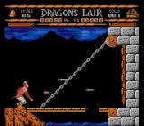 Sullivan Bluth Presents Dragon's Lair NES Dirk just killed the dragon, but must duck a last time to avoid the dragon's fire ball.