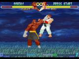 Street Fighter Alpha 2 PlayStation Sagat grabs Ryu by the head: now, he is about to execute his next attack!