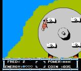 The Flintstones: The Rescue of Dino & Hoppy NES Fred grabs onto a platform of the rotating wheel