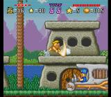 The Flintstones: The Treasure of Sierra Madrock SNES Barney is destroying a barrel