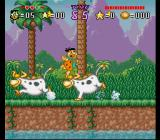 The Flintstones: The Treasure of Sierra Madrock SNES Fred dodging some cows