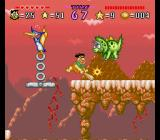 The Flintstones: The Treasure of Sierra Madrock SNES Fred hitting a triceratops