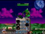 Rampage World Tour Nintendo 64 Lizzie pummels a rooftop