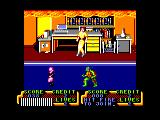 Teenage Mutant Ninja Turtles Amstrad CPC April O' Neil looks safe from the fire on the ceiling