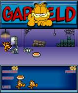 Garfield: Robocats from Outer Space! J2ME First level: Garfield attacks with his paws.