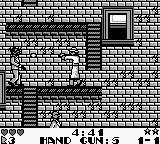 Dick Tracy Game Boy Dick Tracy makes his way down to ground level, but Big Boy's men stand in his way.